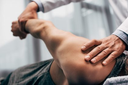 Chiropractor Working on Male Patient