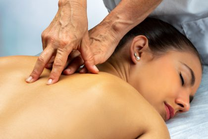 Physiotherapist at physio clinic in Halifax working on woman's back